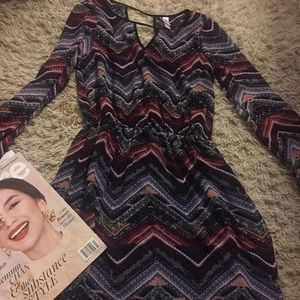 Long sleeve bohemian inspired dress.